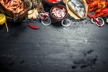 Fototapete - Varied fresh seafood.
