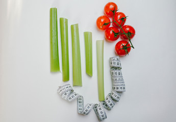 celery, tomatoes and tape on a white background