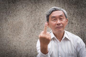 angry upset senior old man giving middle finger rude obscene gesture