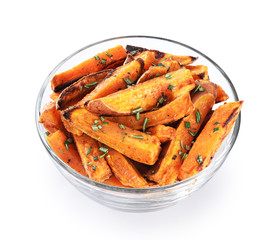 Baked sweet potato in glass bowl isolated on white background.