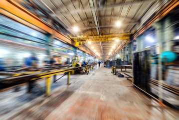 Factory shop. Abstract industrial background, motion blur effect.