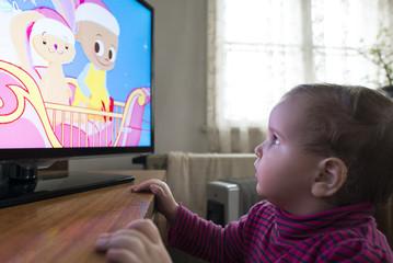 Small girl watch TV