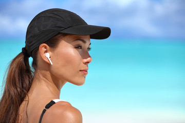 Wireless earbuds running woman on fitness workout