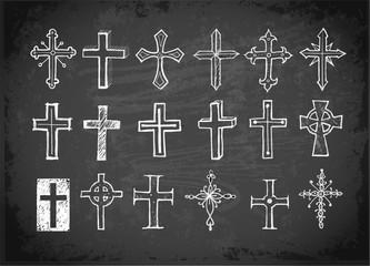 Big set of doodle sketch crosses on blackboard background