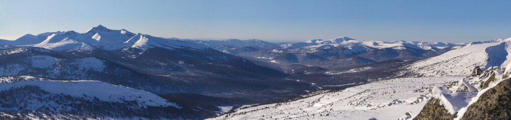 Winter mountain landscape overlooking the of the forest valley.