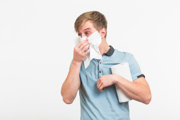 Young man with handkerchief. Sick guy isolated has runny nose on white background