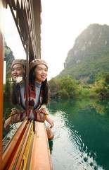 Girl enjoying the ride on a wooden tourist boat