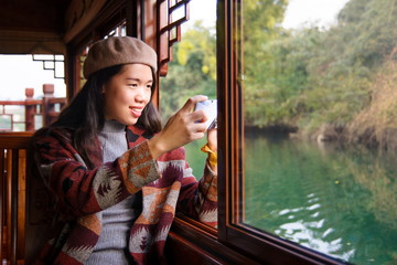 Girl taking picture from on a cruise