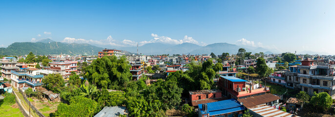 Panoramic view of Pokhara in Nepal. The Machapuchare and the Annapurna range in the background.