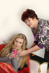 grandmother takes care of her ill granddaughter