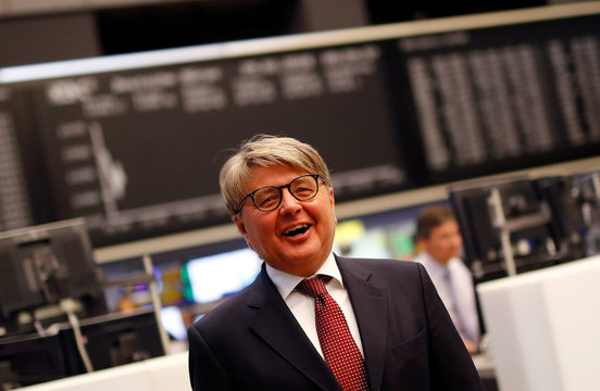 Theodor Weimer, new CEO of German stock exchange Deutsche Boerse AG, smiles as he informs the media about the planned renovations at the trading floor of Frankfurt's stock exchange in Frankfurt