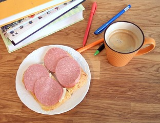 Breakfast of the student, sandwiches with sausage and coffee