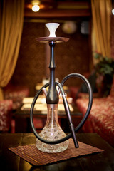 Glass hookah on the table in the living room shisha