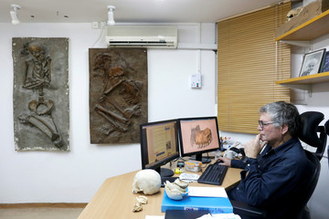 Prof. Israel Hershkovitz of the Department of Anatomy and Anthropology at Tel Aviv University sits at his desk in his office in Tel Aviv