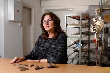 Prof. Mina Weinstein-Evron presents additional findings from the cave in which the jaw bone that scientists call the oldest-known Homo sapiens remains outside Africa was found, during an interview in Tel Aviv