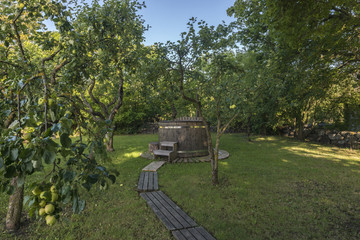 Hot tub among apple trees