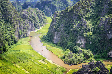 Aerial view of the river among rice fields and limestone mountains, vietnamese scenic landscape at ninh Binh, Vietnam