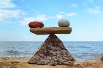 Symmetric balance of stones