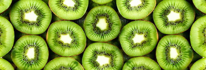 Fresh organic kiwi fruit sliced. Food frame with copy space for your text. Banner. Green kiwi circles background