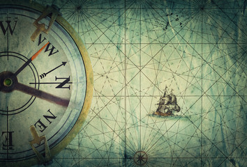 Wall Mural - Compass on vintage map. Adventure, travel, stories background.