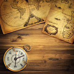 Fototapete - Old vintage retro compass on ancient map background. Travel geography navigation concept background.