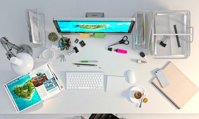 Office desk with computer, stationery, magazine with paradise island advertising.