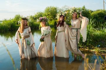 Beautiful women with flower wreath in water