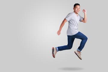 Levitation. Young Asian man jumping dancing walking