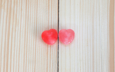 Two hearts candy on wood plate , valentine day concept.