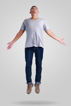 Levitation. Young Man Walking Jumping on Air