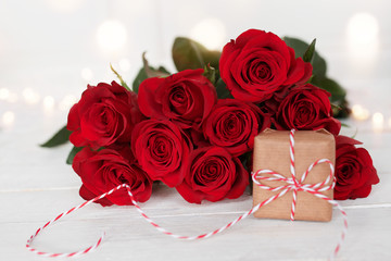 Red roses with a gift for wedding