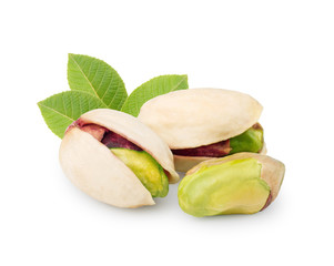 Pistachios with leaves isolated on white background