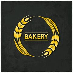 golden wheat bakery symbol black background