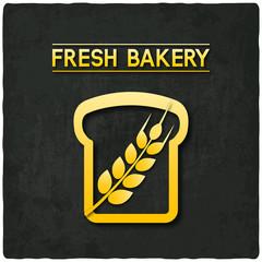 golden bread bakery symbol black background