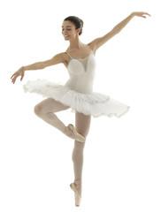 ballerina with white tutu doing the pique pose on white background.