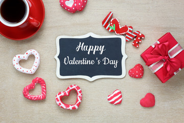 Table top view aerial image of decoration valentine's day background concept.Flat lay arrangement of blank space blackboard & essential items on modern rustic white wooden for mock up creative design