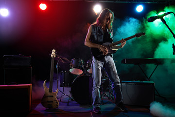 The guitarist performs on stage.