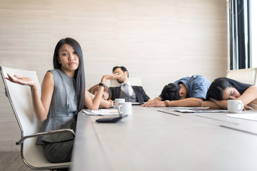 In selective focus of Business people sleeping in the conference room during a meeting. Setup studio shooting.
