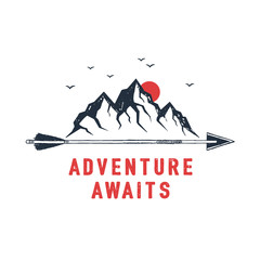"Hand drawn travel badge with mountains textured vector illustration and ""Adventure awaits"" inspirational lettering."