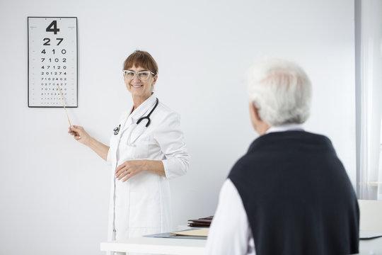 Oculist doing eye exam