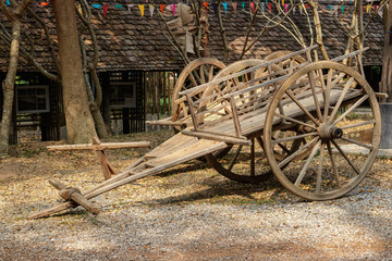 The carts are made of wood, which is used to transport people and things in the past.