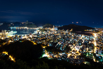Wall Mural - Night View of Sugarloaf Mountain and Botafogo in Rio de Janeiro, Brazil