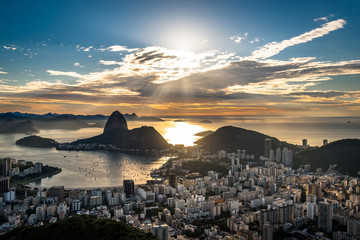 Wall Mural - View of Rio de Janeiro City Landmark - the Sugarloaf Mountain, with the Sun Shining Above