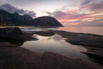 Wall Mural - Sunrise Behind Rocks Reflected in Water