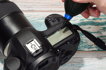 Cleaning professional digital camera body concept