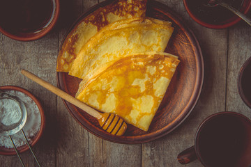 Homemade crepes with honey. Selective focus.