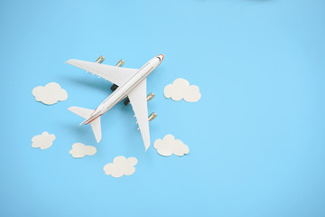 Flat lay design of travel concept with plane and cloud on blue background with copy space. Fototapete