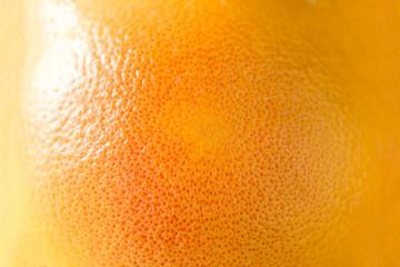 Texture of fresh bright orange peel, closeup, copy space. Macro of orange fruit. Citrus fruit...