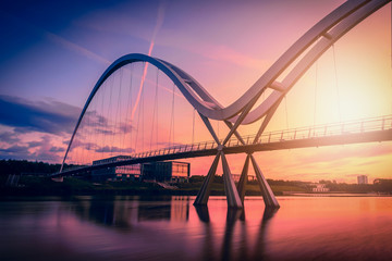 Infinity Bridge on dramatic sky at sunset in Stockton-on-Tees, UK.