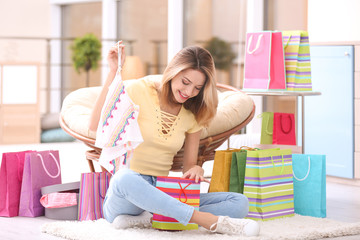 Beautiful woman after successful shopping at home